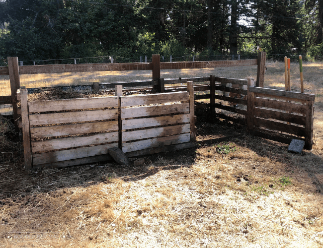 A 3-bin compost system with wood slat doors
