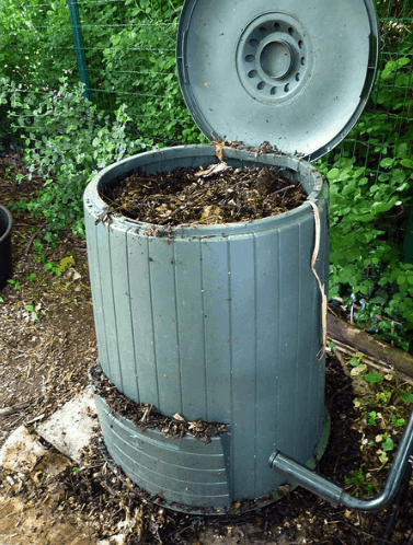 A round continuous compost bin with the lid open