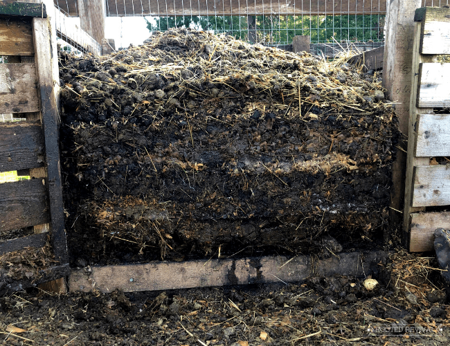 A pile of compost showing the layers of materials